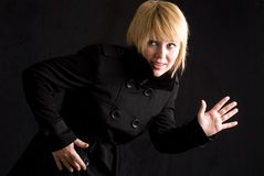 Blond woman and black trench coat Royalty Free Stock Photo