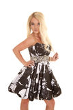 Blond woman black white dress play with hair Stock Images