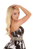 Blond woman black white dress side hand hair serious Stock Image