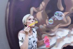 Woman is blowing bubbles Royalty Free Stock Photos