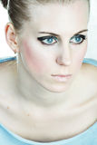 Blond Woman With Blue Eyes. Close up beauty portrait of a blond caucasian female royalty free stock photos