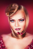 Blond woman with blue eyes. And cherry Stock Photo
