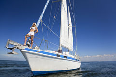 Blond Woman on the Bow of a Sail Boat Stock Photography