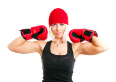 Blond woman with boxing gloves exercising. Smiling blond woman with boxing gloves exercising Stock Image