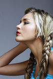 Blond woman with braids. Stock Photos
