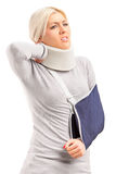A blond woman with broken arm and injured neck  Royalty Free Stock Image
