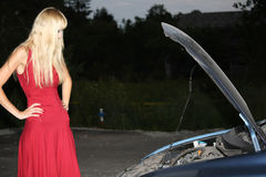 Blond woman with broken car Royalty Free Stock Photos
