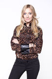 Blond woman in an brown animal print blouse Royalty Free Stock Image