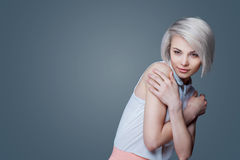 Blond woman with brown eyes Stock Photos