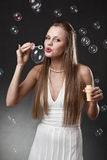 Blond woman with bubbles Royalty Free Stock Images
