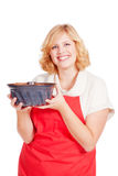 Blond woman with bundt cake and red apron Royalty Free Stock Photo