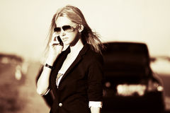 Blond woman calling on the cell phone Stock Image