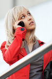 Blond woman calling on the phone Stock Photos