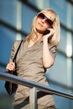 Blond woman calling on the phone Stock Photography