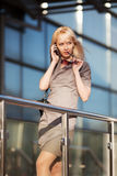 Blond woman calling on the phone Royalty Free Stock Photography