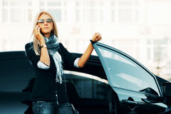 Fashion woman calling on the phone at the car Stock Photography
