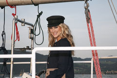 Blond woman capitan Stock Photos