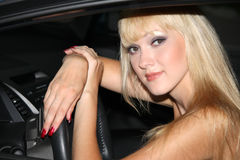 Blond woman in a car Royalty Free Stock Photos