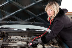 Blond woman with car trouble Stock Images