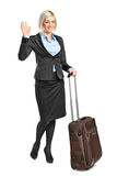 Blond woman carrying her luggage and g Royalty Free Stock Photo