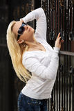Blond woman at the cast iron fence Royalty Free Stock Images