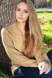 Blond woman in casual cozy clothes, posing in autumn park Royalty Free Stock Photos