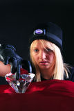 Blond woman cat burglar stealing a large diamond Royalty Free Stock Images