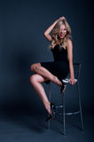 Blond woman on a chair Royalty Free Stock Photo