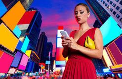 Blond woman chat writing smartphone in NYC Royalty Free Stock Image