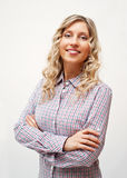 Blond woman in checked shirt Stock Photography