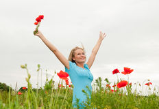 Blond woman cheering Stock Photography