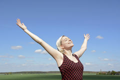 Blond woman cheering Stock Photo