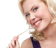 Blond woman and chewing gum Royalty Free Stock Image