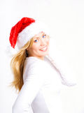 Blond woman in christmas cap Stock Photos