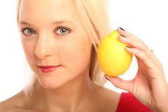 Blond woman with a citron Royalty Free Stock Photos