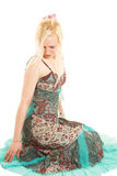 Blond woman in colorful dress Stock Photography