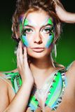 Blond woman with colorful makeup Stock Photos