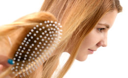 Blond woman combing Royalty Free Stock Photo