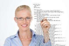 Blond woman correcting a script Stock Photo