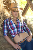 Blond woman in cowboy hat stock images