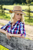 Blond woman in cowboy hat royalty free stock image