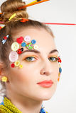 Blond woman with creativity hairstyle with colored buttons and f Royalty Free Stock Image