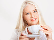 Blond woman with cup of tea Stock Photography