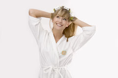Blond woman with curler Royalty Free Stock Images