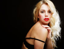 Blond woman with  curly hair in black lingerie Royalty Free Stock Images