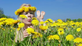 Blond woman and dandelions. stock footage