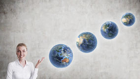 Blond woman with diagonally aligned planets Stock Photos