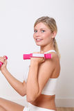 Blond woman doing fitness exercises Stock Photos