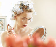 Blond woman doing a make up Royalty Free Stock Image