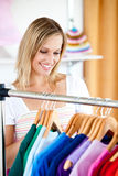 Blond woman is doing shopping stock image